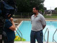 Man being interviewed at pool