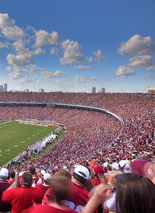 Crowds cheer on Texas and Oklahoma football teams at the Red River Rivalry game